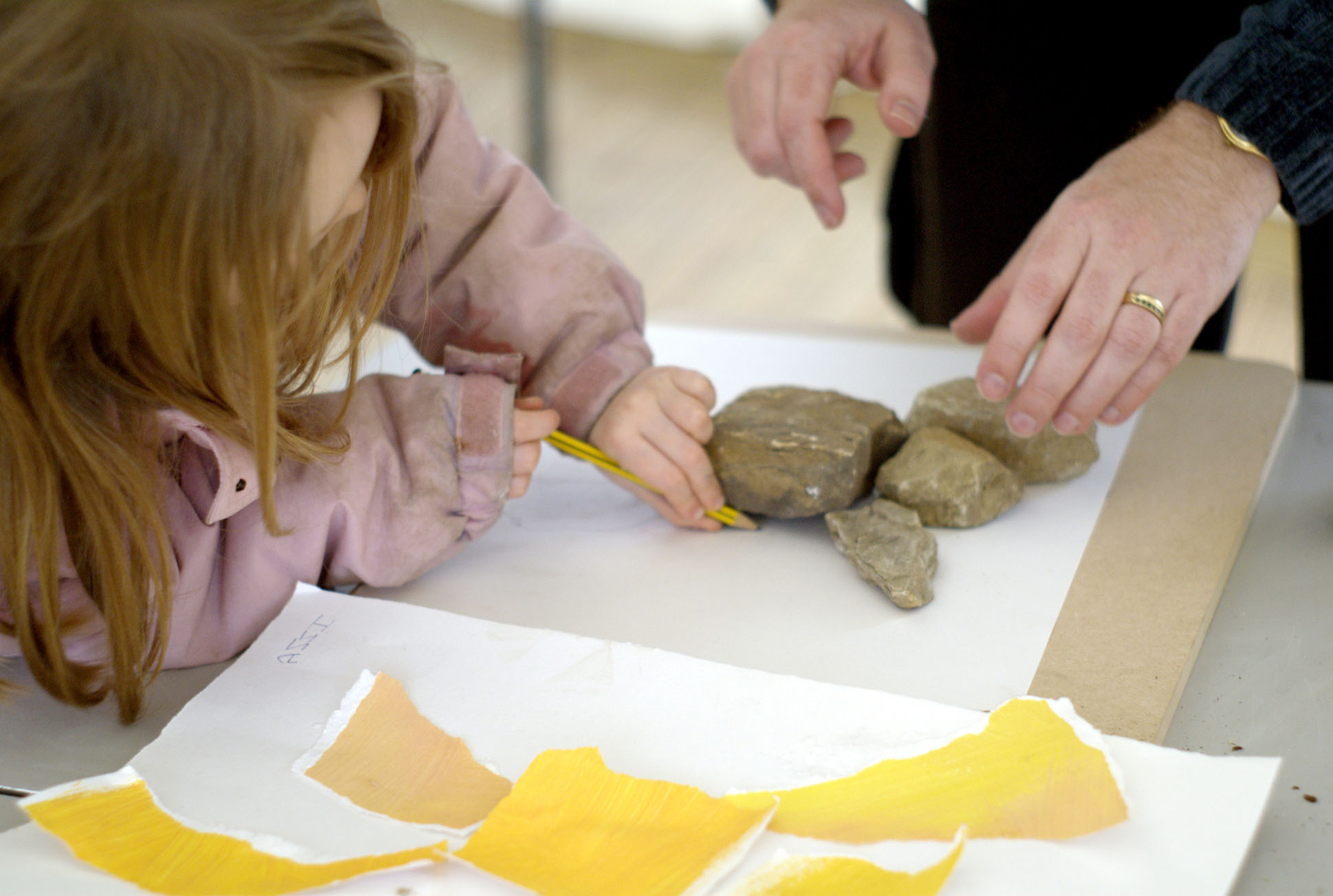 child-drawing-stones-yorkshire-sculpture-park-event-photography