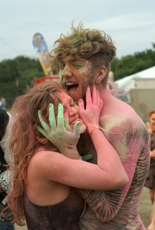 Man and woman in coloured paint at Beach Break Live festival