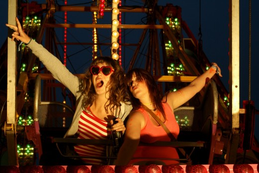 Two girls on a fairground ride at Beach break Live festival