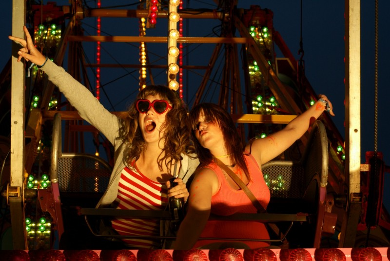 Two girls on a fairground ride at Beach break Live festival