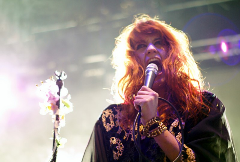 Florence Welch screams into a microphone