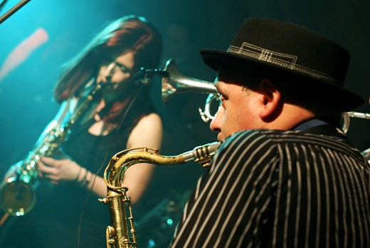 Two people playing saxophone