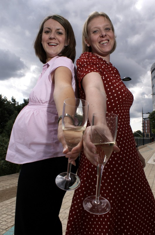 Two women with champagne glasses