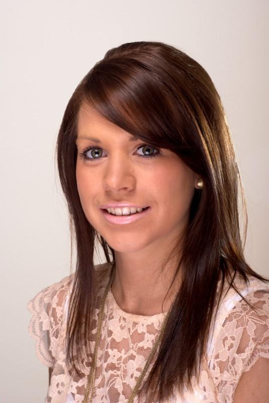 Head shot of a woman smiling at camera