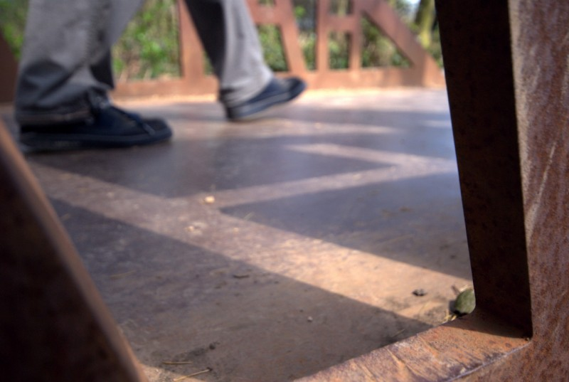 Feet walking across a bridge at Yorkshire sculpture park