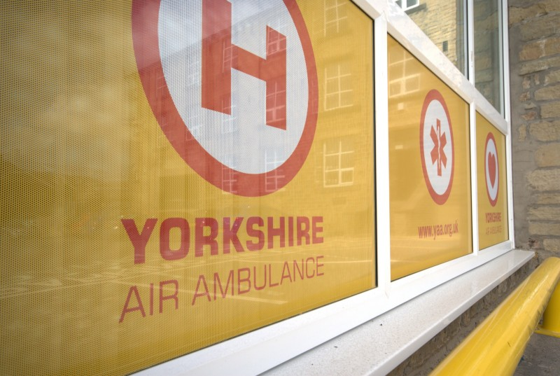 Outside window and logo of Yorkshire air ambulance's headquarters