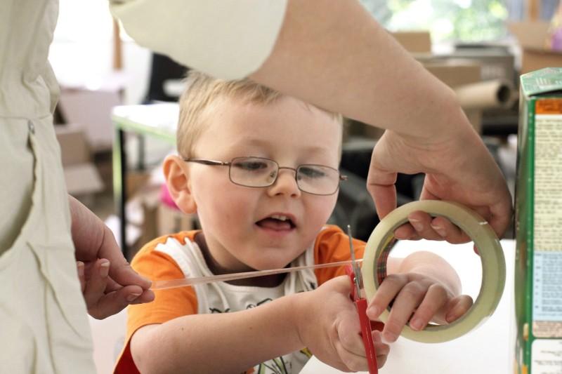 Boy cutting Sellotape at Yorkshire Sculpture Park