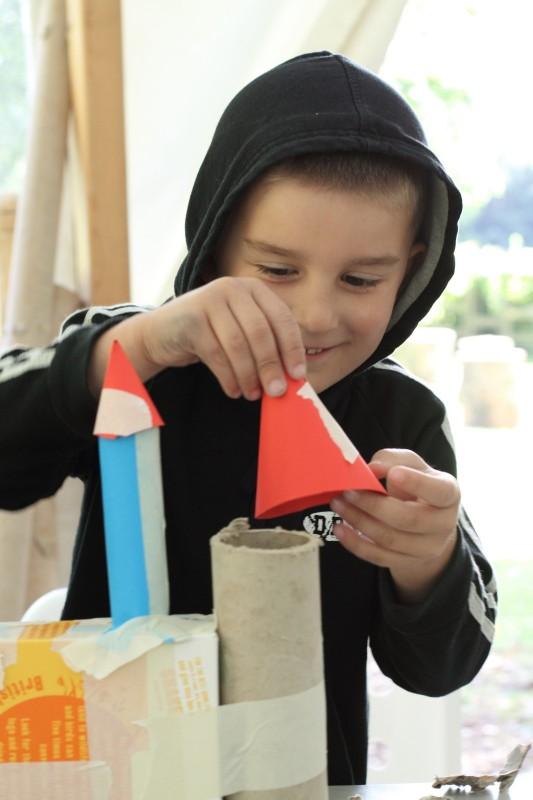 Boy arranging paper sculptures at Yorkshire Sculpture Park