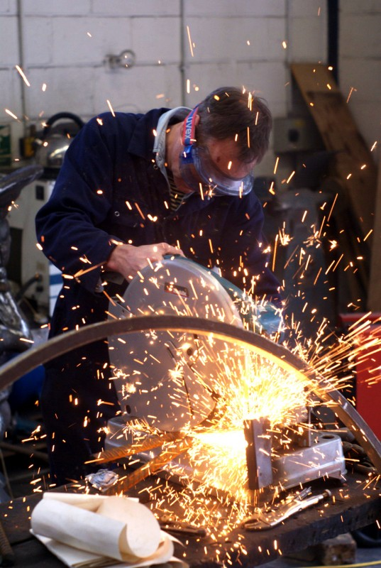 Sparks coming from a man grinding metal