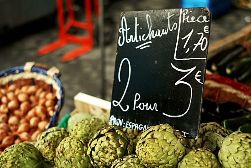 A pile of artichokes on a stall at a French market