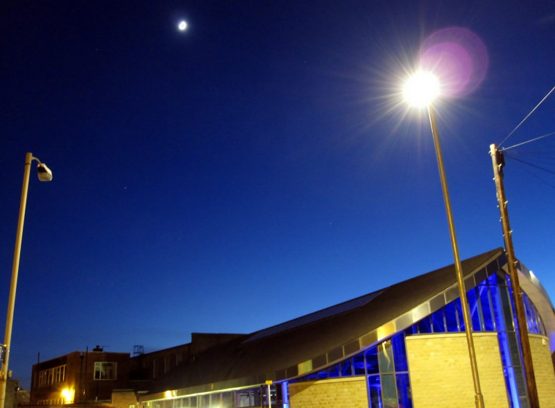 Dusk over Otley library in Leeds lit by street lights