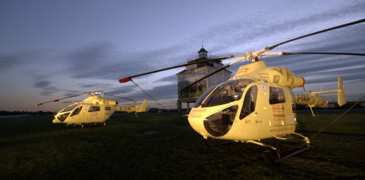 Two yorkshire air ambulance helicopters at sunset at York racecourse