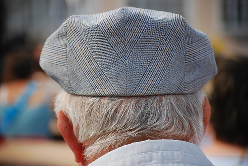 Back of an old Yorkshireman's head wearing a flat cap