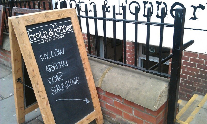 "Sign outside a cafe in Leeds that reads ""follow arrow for sunshine"""