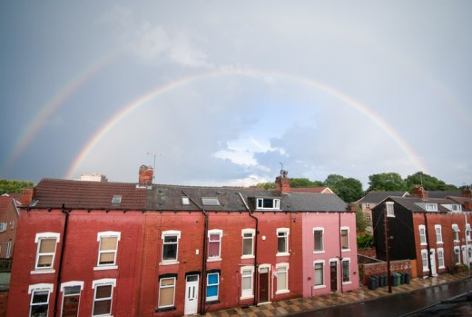 Two rainbows in a dark sky over terraced houses in Leeds